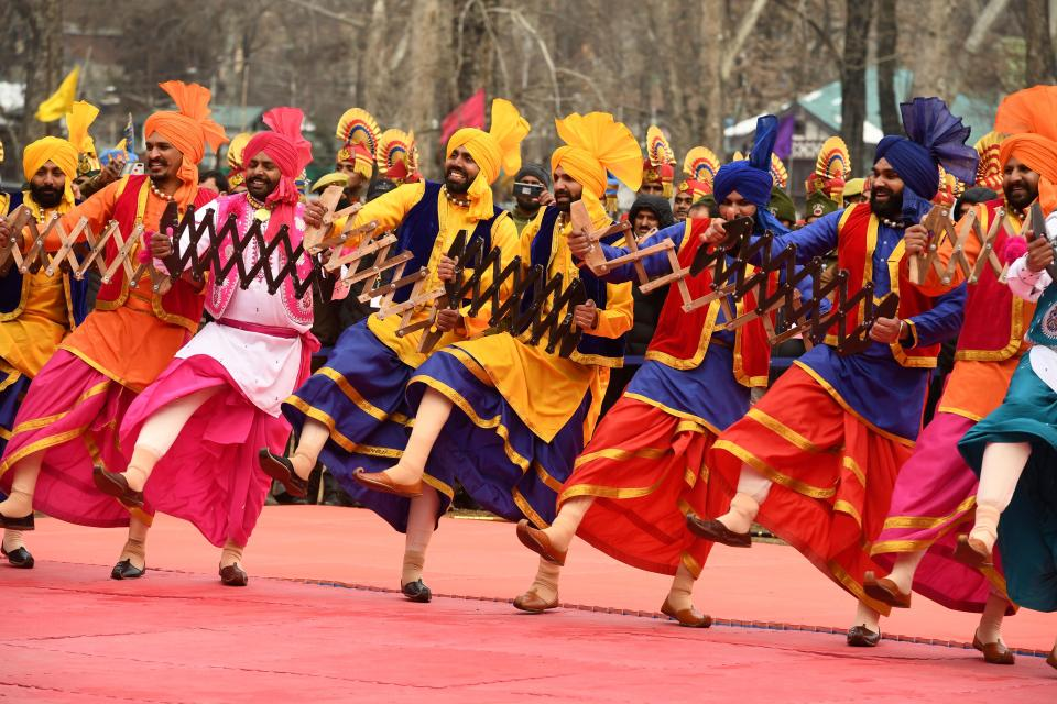 Performers dance during the Republic Day parade at a stadium in Srinagar on January 26, 2021. (Photo by Tauseef MUSTAFA / AFP) (Photo by TAUSEEF MUSTAFA/AFP via Getty Images)