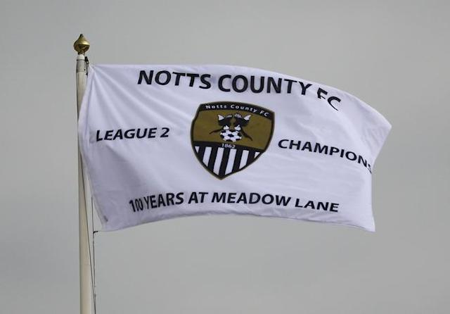 NOTTINGHAM, ENGLAND - MAY 01: (FILE PHOTO) In 2012 the Notts County Football Club, the oldest of all the football clubs in the world, will celebrates 150 years since being formed. Please refer to the following profile on Getty Images Archival for further imagery. http://www.gettyimages.co.uk/Search/Search.aspx?EventId=136199907&EditorialProduct=Archival A flag at Meadow Lane shows that Notts County are League Two Champions during the Coca-Cola League Two match between Notts County and Cheltenham Town at Meadow Lane on May 1, 2010 in Nottingham, England. (Photo by Matthew Lewis/Getty Images)