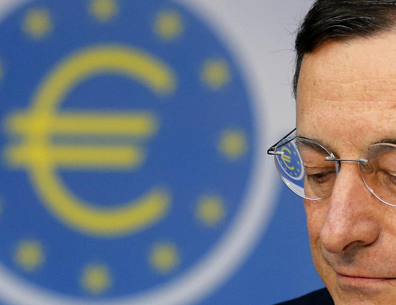 President of European Central Bank Mario Draghi listens to questions as the Euro logo is reflected in his glasses during a news conference in Frankfurt, Germany, Thursday, Sept. 6, 2012, following a meeting of the ECB governing council concerning the further strategies in the European financial crisis. (AP Photo/Michael Probst)