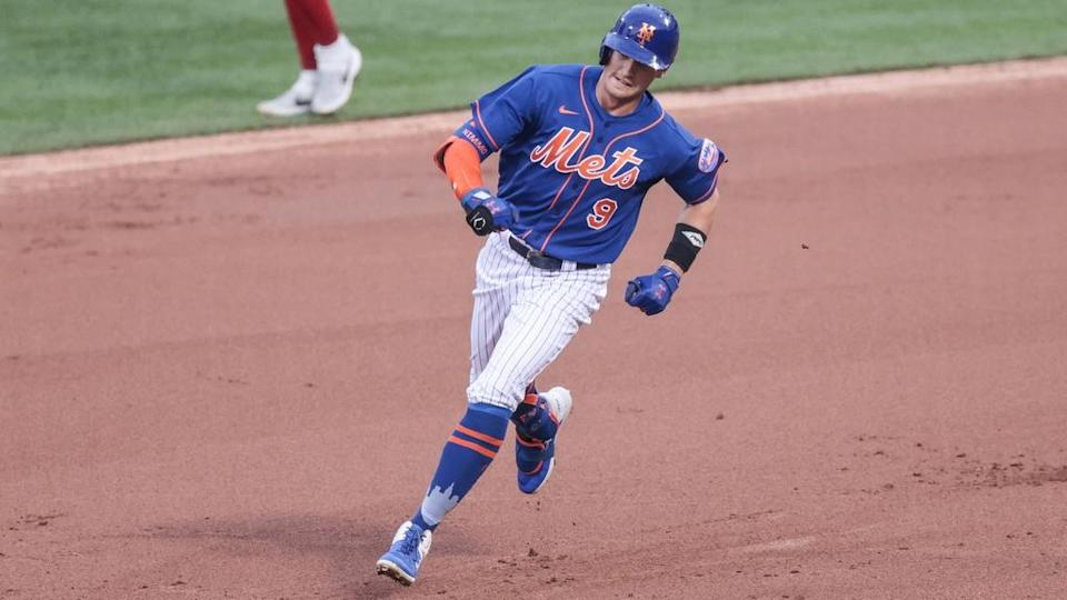 Brandon Nimmo rounds the bases after hitting home run, wearing blue jersey