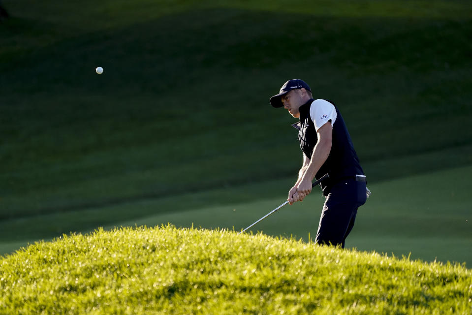 Justin Thomas, of the United States, chips onto the 18th green during the third round of the US Open Golf Championship, Saturday, Sept. 19, 2020, in Mamaroneck, N.Y. (AP Photo/Charles Krupa)