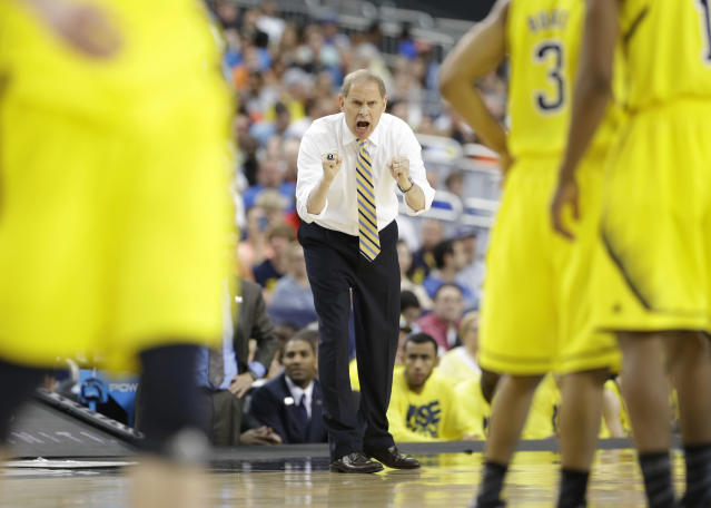 Michigan head coach John Beilein reacts on the sideline against Florida during the second half of a regional final game in the NCAA college basketball tournament, Sunday, March 31, 2013, in Arlington, Texas. (AP Photo/Tony Gutierrez)