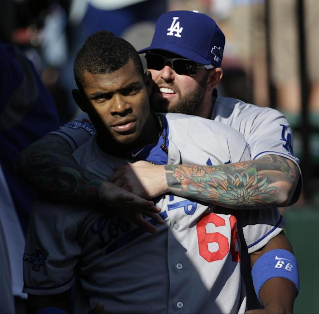 Los Angeles Dodgers' Yasiel Puig (66) and Chris Withrow joke around before Game 2 of the National League baseball championship series against the St. Louis Cardinals Saturday, Oct. 12, 2013, in St. Louis. (AP Photo/David J. Phillip)
