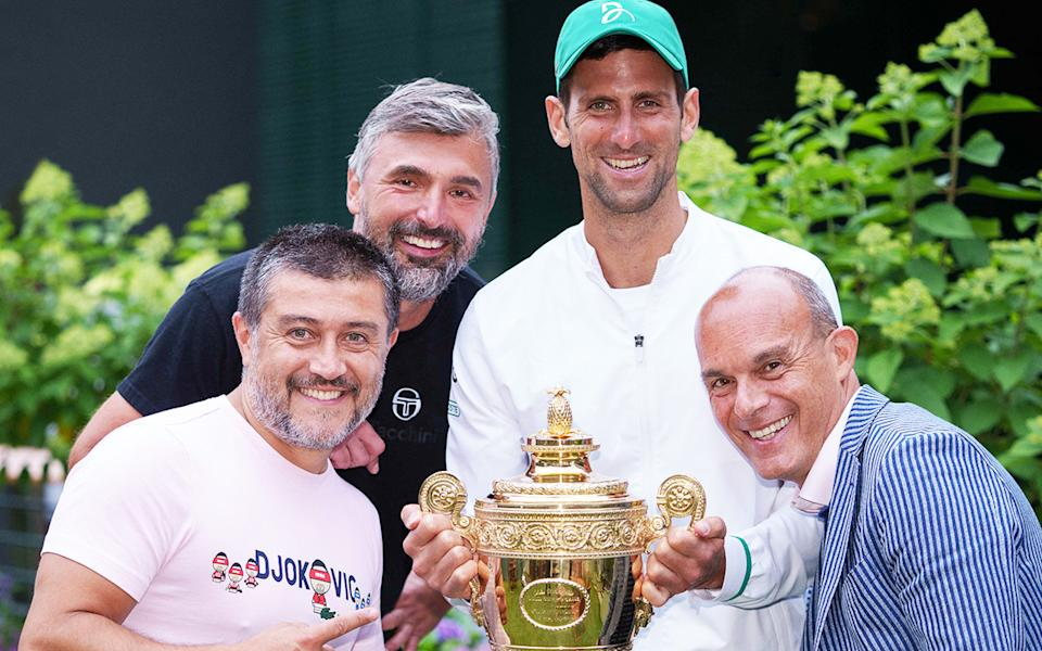 Novak Djokovic, pictured here with his team after winning Wimbledon.