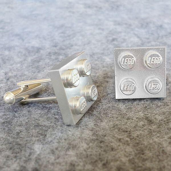 """<p>Putting these adorable cuff links together with your kids will make for a thoughtful gift from the whole family.</p><p><strong>Get the tutorial at <a href=""""https://www.dreamalittlebigger.com/post/delight-dorky-dads-this-fathers-day.html"""" rel=""""nofollow noopener"""" target=""""_blank"""" data-ylk=""""slk:Dream a Little Bigger"""" class=""""link rapid-noclick-resp"""">Dream a Little Bigger</a>.</strong></p><p><strong><a class=""""link rapid-noclick-resp"""" href=""""https://www.amazon.com/Krylon-K02788007-Fusion-Spray-Silver/dp/B07LFZFJZD/?tag=syn-yahoo-20&ascsubtag=%5Bartid%7C10050.g.1171%5Bsrc%7Cyahoo-us"""" rel=""""nofollow noopener"""" target=""""_blank"""" data-ylk=""""slk:SHOP SILVER SPRAY PAINT"""">SHOP SILVER SPRAY PAINT</a><br></strong></p>"""