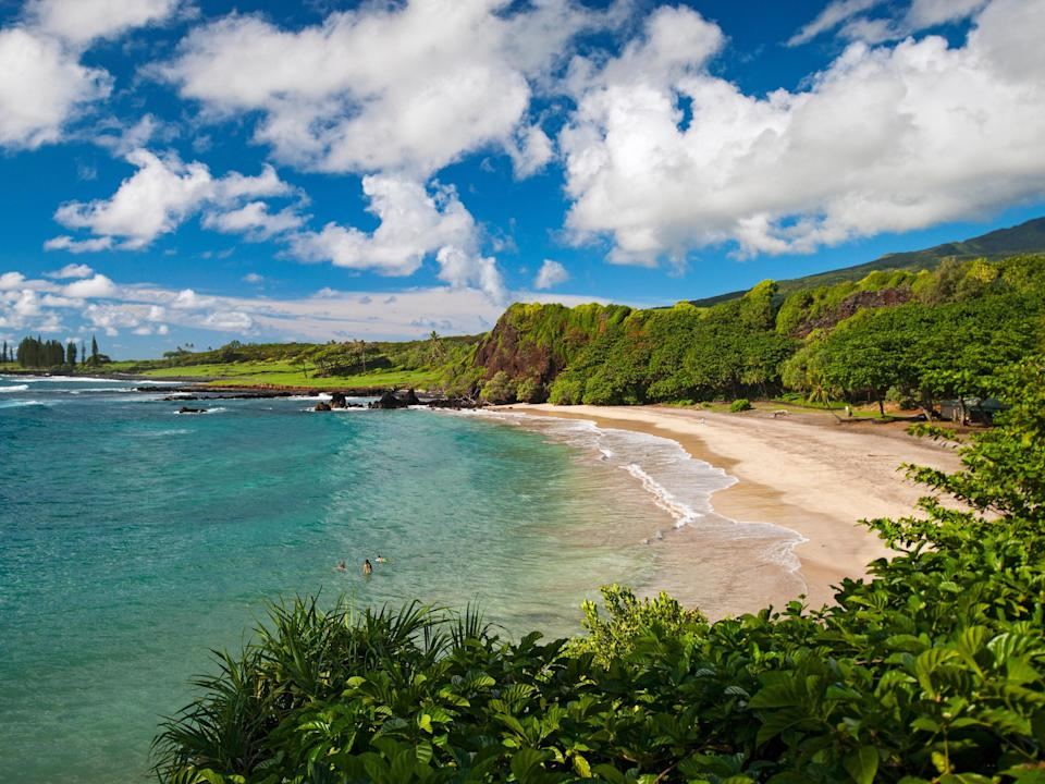 """Though it's a mere pocket of sand at the <a href=""""https://www.cntraveler.com/activities/maui/road-to-hana?mbid=synd_yahoo_rss"""" rel=""""nofollow noopener"""" target=""""_blank"""" data-ylk=""""slk:Hana"""" class=""""link rapid-noclick-resp"""">Hana</a> end of Maui—no longer than 1,000 feet—Hamoa is undoubtedly one of Maui's most beautiful beaches. It's backed by a thick forest of Hala trees, its shore is wide and golden, and its waters a brilliant shade of aquamarine. But be warned: as pretty as it looks, Hamoa isn't protected by outlying reefs, which means the surf can be quite powerful, so it's best to wade in the shallows or enjoy the view from the shore. Pro tip: the newly opened <a href=""""http://www.cntraveler.com/hotels/hana/hana-maui-resort?mbid=synd_yahoo_rss"""" rel=""""nofollow noopener"""" target=""""_blank"""" data-ylk=""""slk:Hana-Maui Resort"""" class=""""link rapid-noclick-resp"""">Hana-Maui Resort</a> by Hyatt (formerly the Travaasa Hana) offers guests shuttles to and from Hamoa Beach daily, beginning 11 a.m."""