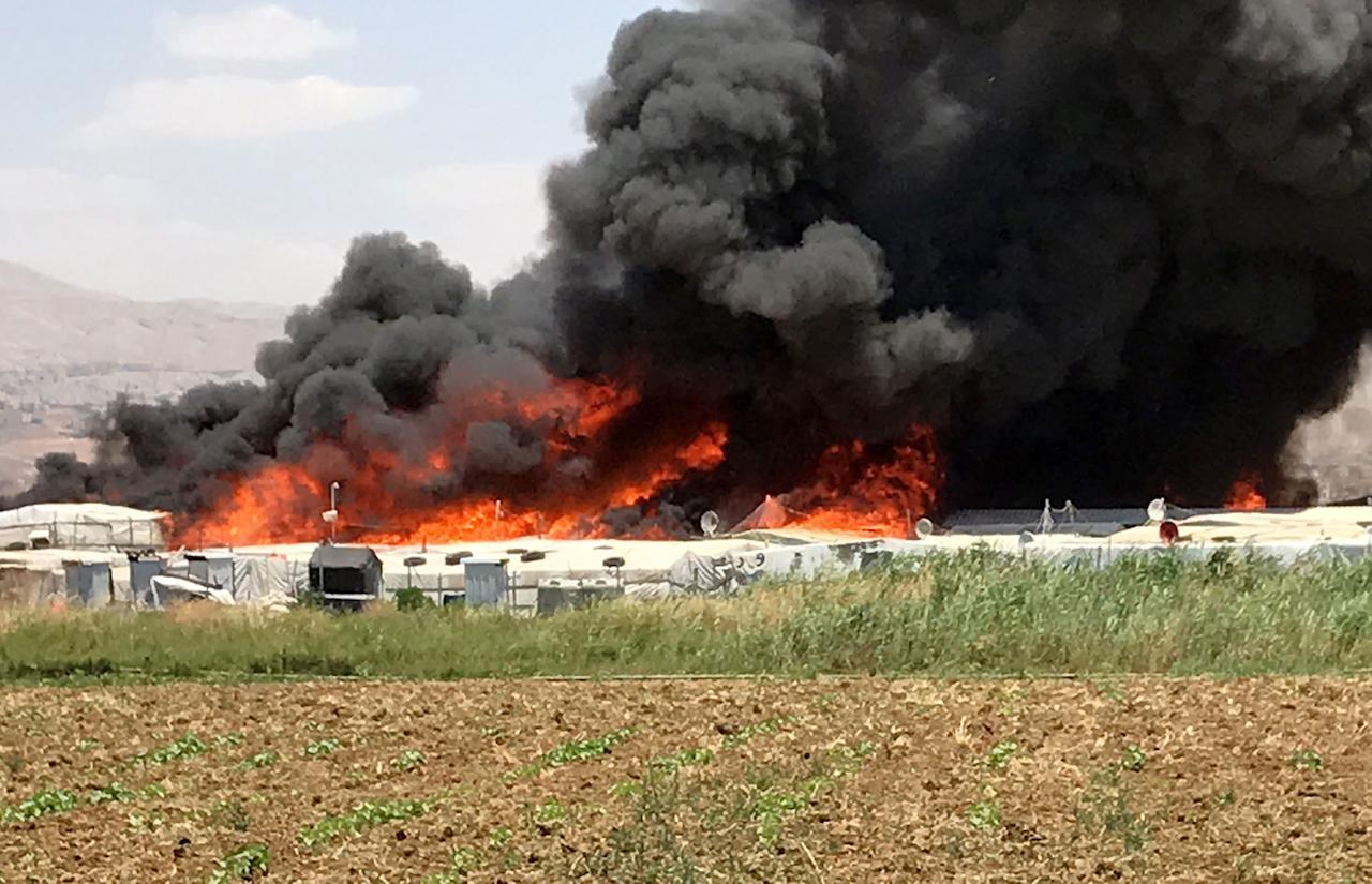 <p>Smoke rises after fire breaks out due to an unknown reason at the Qob Elias refugee camp at the Beqaa valley in Lebanon on July 1, 2017. (Hasan Jarrah/Anadolu Agency/Getty Images) </p>