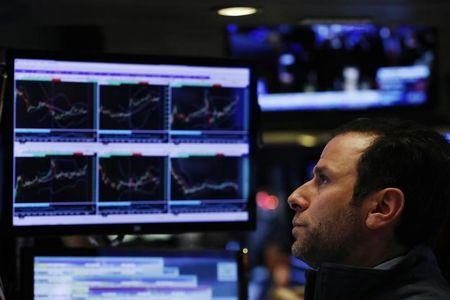 FILE PHOTO - A trader watches his screen on floor of the New York Stock Exchange (NYSE) shortly before the close of trading in New York, U.S., December 13, 2016.  REUTERS/Lucas Jackson