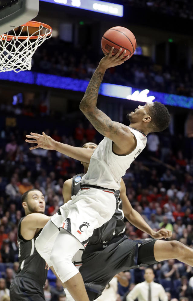 Cincinnati guard Jacob Evans (1) drives to the basket, during the first half of a second-round game against Nevada, in the NCAA college basketball tournament in Nashville, Tenn., Sunday, March 18, 2018. (AP Photo/Mark Humphrey)