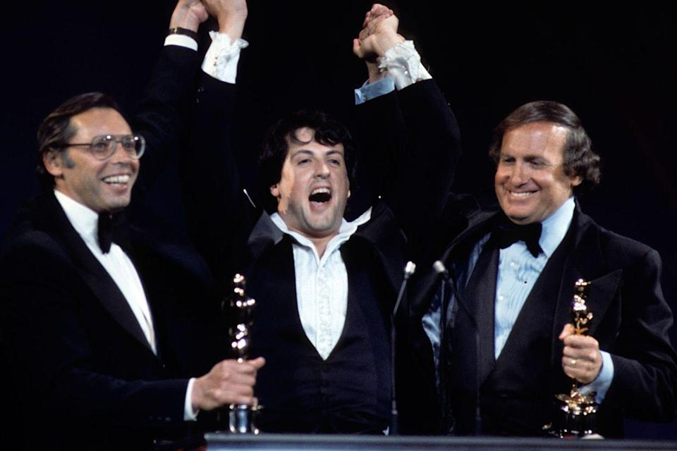 "<p>Irwin Winkler, Sylvester Stallone, and Robert Chartoff were <a href=""https://www.goodhousekeeping.com/life/inspirational-stories/interviews/a19319/stars-keep-oscars/"" rel=""nofollow noopener"" target=""_blank"" data-ylk=""slk:ecstatic over Rocky winning Best Picture"" class=""link rapid-noclick-resp"">ecstatic over <em>Rocky </em>winning Best Picture</a>. John G. Avildsen also won Best Director for the film.</p>"