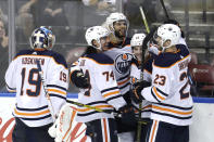 Edmonton Oilers defenseman Darnell Nurse (25), third from left, celebrates after scoring an empty-net goal during the third period of an NHL hockey game against the Florida Panthers, Saturday, Feb. 15, 2020, in Sunrise, Fla. (AP Photo/Lynne Sladky)