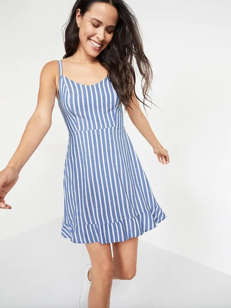 <p>Thin straps can sometimes feel too revealing, but the <span>Dobby-Stripe Ruffle-Hem Fit &amp; Flare Cami Dress </span> ($30, originally $35) creates a nice balance by having the hem hit at the knees.</p>