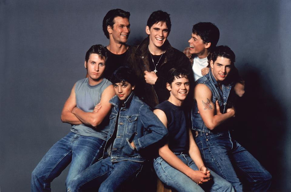 American actors Patrick Swayze, Matt Dillon, Rob Lowe, Emilio Estevez, Ralph Macchio, Thomas C. Howell, and Tom Cruise on the set of The Outsiders, directed by Francis Ford Coppola. (Photo by Sunset Boulevard/Corbis via Getty Images)