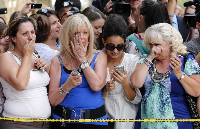 From left; Virginia Aguiar, Jane Crook, Nisha Kataria, and Debbie Lambert all react in Phoenix, Wednesday, May 8, 2013 to a guilty verdict in the trial of Jodi Arias, a waitress and aspiring photographer charged with killing her boyfriend, Travis Alexander, in Arizona in 2008. The four month trial included graphic details of their sexual escapades and photos of Alexander just after his death. (AP Photo/Matt York)