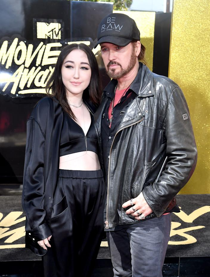 Actor/singers Noah Cyrus (L) and Billy Ray Cyrus attend the 2017 MTV Movie And TV Awards at The Shrine Auditorium on May 7, 2017 in Los Angeles, California.