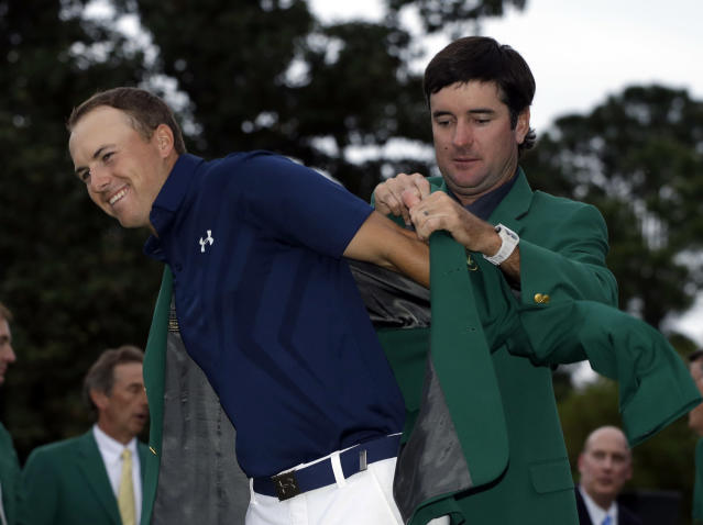 "<a class=""link rapid-noclick-resp"" href=""/pga/players/4713/"" data-ylk=""slk:Bubba Watson"">Bubba Watson</a> helps Jordan Spieth put on his green jacket for the second time after winning the Masters golf tournament Sunday, April 12, 2015, in Augusta, Ga. (AP/Darron Cummings)"