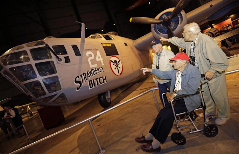 World War II veterans, left to right, Jim McClain, William Newbold, and Bob Rans, view a B24 bomber like the ones they flew on the Ploesti Raid while touring the United States Air Force Museum, Wednesday, July 31, 2013, in Dayton, Ohio. The planes flew a dangerous low altitude raid on Aug. 1, 1943, targeting heavily defended oil fields in occupied Romania. Survivors of the raid are having a 70th reunion Thursday in Dayton. (AP Photo/Al Behrman)