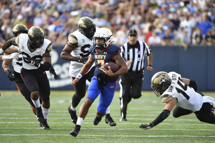 Navy quarterback Xavier Arline (7) runs the ball during the second half of an NCAA college football game against Air Force, Saturday, Sept. 11, 2021, in Annapolis, Md. (AP Photo/Terrance Williams)