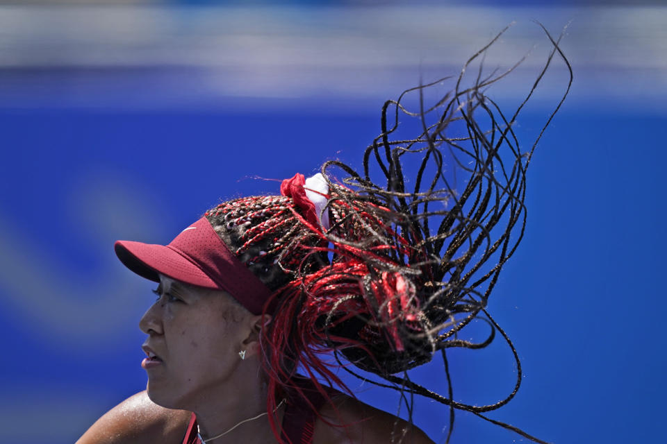 Naomi Osaka, of Japan, plays against Saisai Zheng, of China, during the first round of the tennis competition at the 2020 Summer Olympics, Sunday, July 25, 2021, in Tokyo, Japan. (AP Photo/Seth Wenig)
