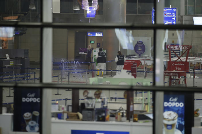 <p>Turkish forensic police officers work inside Istanbul's Ataturk airport, late Tuesday, June 28, 2016. (AP Photo/Emrah Gurel) </p>