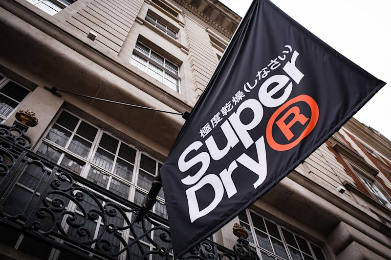 A flag for clothing retailer Superdry hangs outside the company's flagship branch on Regent Street in London, England, on July 7, 2019. Superdry will release its full-year results this Thursday, July 10, a week later than planned, after announcing their postponement in late June. Recent months have seen Superdry beset with problems, from poor sales performance to a boardroom walkout after founder Julian Dunkerton won a shareholder vote to rejoin the company, becoming interim CEO in April. The following month saw the chain issue its third profit warning in a year, adding to investor woes. (Photo by David Cliff/NurPhoto via Getty Images)