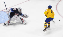 Sweden's Victor Soderstrom (8) loses the puck on a penalty shot against the United States during the second period of an IIHF World Junior Hockey Championship game Thursday, Dec. 31, 2020, in Edmonton, Alberta. (Jason Franson/The Canadian Press via AP)
