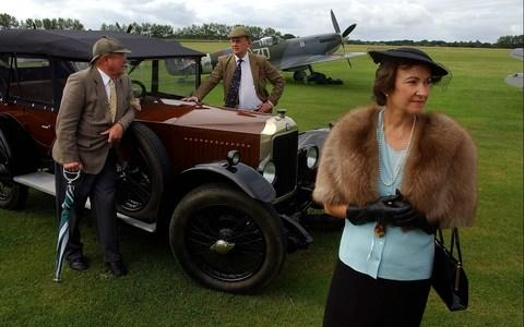 David Llewellyn, Alasdair Emslie & Tessa Llewellyn alongside 1920's Vauxhall and a Spitfire at the Goodwood Revival in W.Sussex, 07-09-2002.Pic by John Robertson, Tel. 07850 931219. - Credit: John Robertson