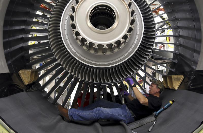 General Electric employee Jim Jones assembles a GE90 engine at the GE Aviation Peebles Test Operations Facility in Peebles, Ohio