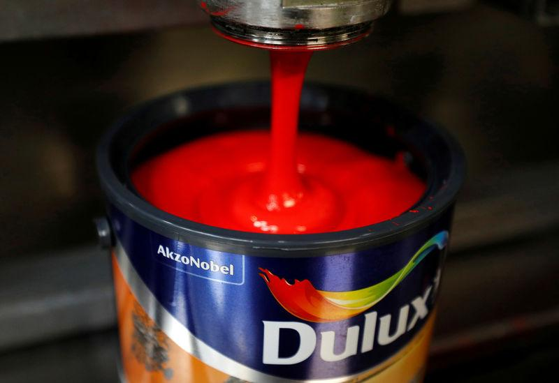 FILE PHOTO: Dulux paint cans are filled on the production line inside AkzoNobel's new paint factory in Ashington, Britain