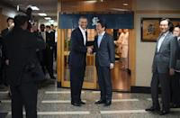 US President Barack Obama (L) shakes hands with Japanese Prime Minister Shinzo Abe before a private dinner at Sukiyabashi Jiro restaurant in Tokyo on April 23, 2014