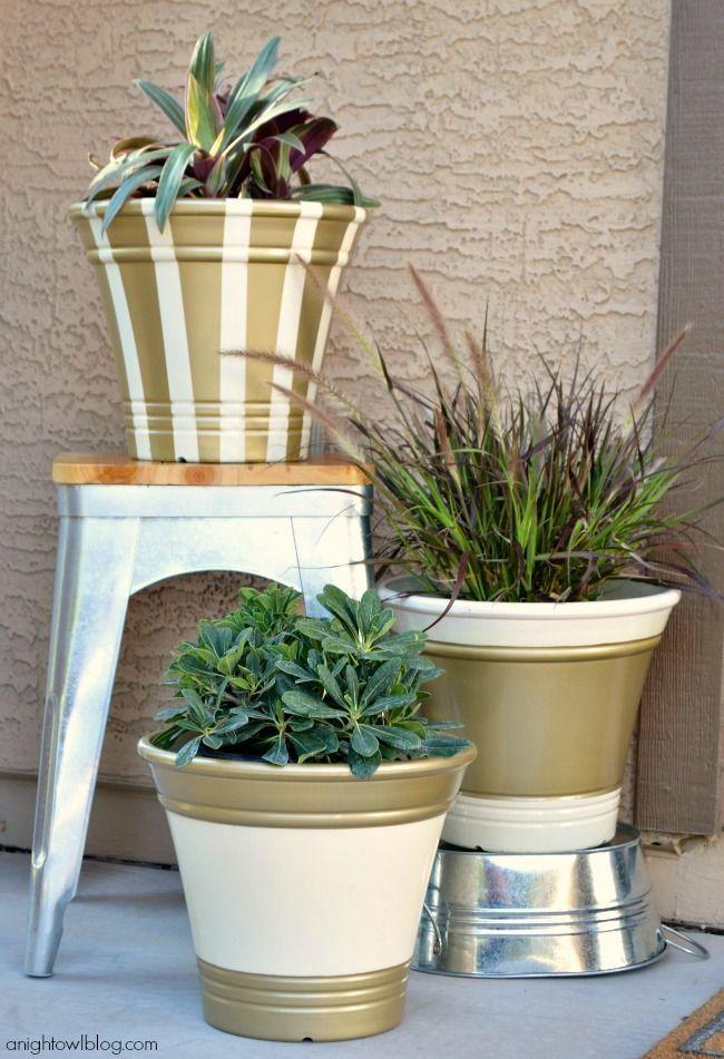 """<p>With a little spray paint, it's easy to turn any old planter into a sophisticated home for your favorite fall blooms. </p><p><a class=""""link rapid-noclick-resp"""" href=""""https://www.anightowlblog.com/golden-fall-planters-scotchblue-painters-tape/"""" rel=""""nofollow noopener"""" target=""""_blank"""" data-ylk=""""slk:GET THE TUTORIAL"""">GET THE TUTORIAL</a></p>"""