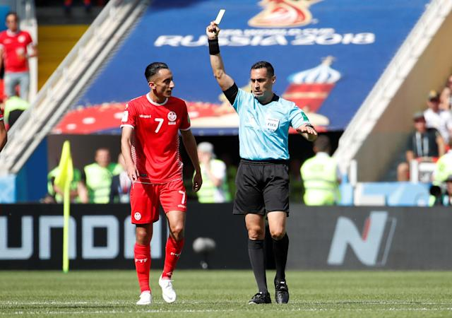Soccer Football - World Cup - Group G - Belgium vs Tunisia - Spartak Stadium, Moscow, Russia - June 23, 2018 Tunisia's Ferjani Sassi is shown a yellow card by referee Jair Marrufo REUTERS/Christian Hartmann