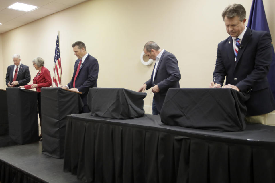 Senate candidates prepare for a GOP senatorial debate In Manhattan, Kan., Saturday, May 23, 2020. David Lindstrom, left, Susan Wagle, second from left, Kris Kobach, middle, Bob Hamilton, second from right, and Dr. Roger Marshall, right, occupy the debate stage. (AP Photo/Orlin Wagner)