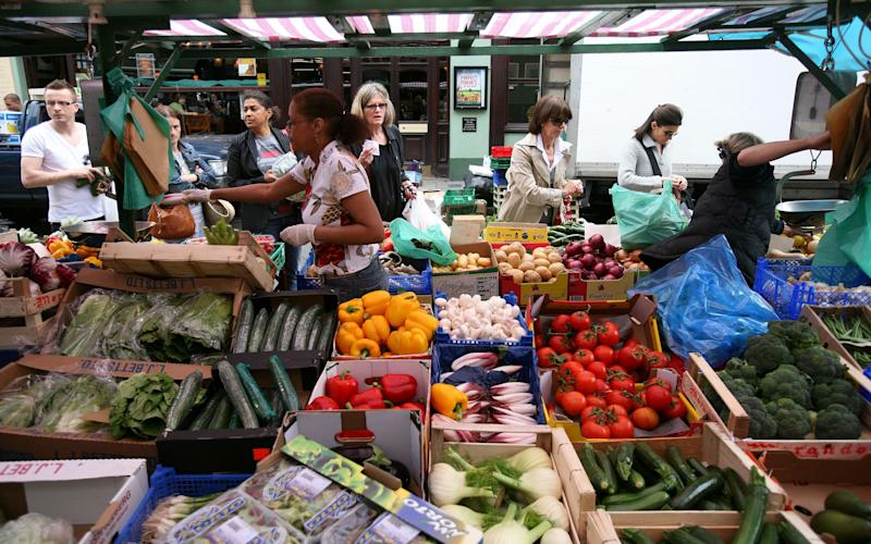 A fruit and vegetable market stall on Portobello road in west London - Credit:  Clara Molden