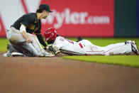Cincinnati Reds' Delino DeShields (26) slides safely in second base before the tag from Pittsburgh Pirates' shortstop Hoy Park (68) during the seventh inning of a baseball game in Cincinnati, Tuesday, Sept 21, 2021. (AP Photo/Bryan Woolston)