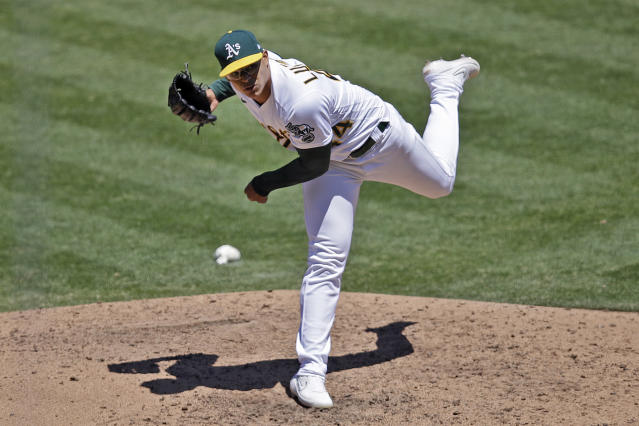 Oakland Athletics pitcher Jesus Luzardo works against the Colorado Rockies in the sixth inning of a baseball game Wednesday, July 29, 2020, in Oakland, Calif. (AP Photo/Ben Margot)