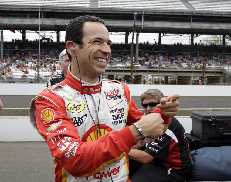 Helio Castroneves, of Brazil, jokes with members of his crew after his qualification run on the first day of qualifications for the Indianapolis 500 auto race at the Indianapolis Motor Speedway in Indianapolis, Saturday, May 18, 2013. (AP Photo/Tom Strattman)