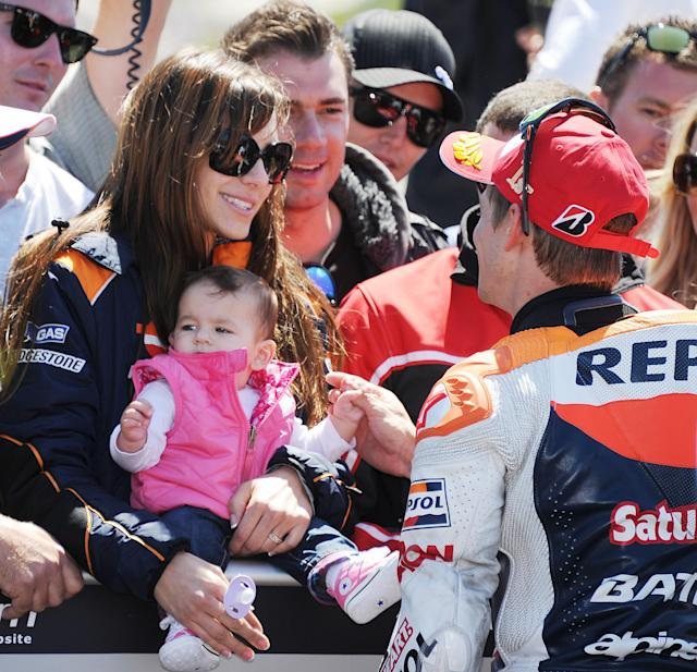 Repsol Honda Team rider Casey Stoner of Australia (R) talks with his wife Adriana Stoner, holding their daughter Alessandra Maria, after Stoner won the Red Bull U.S. Moto GP race at Mazda Raceway Laguna Seca in Monterey, California, July 29 2012. Stoner finished first followed by Yamaha Factory Racing team rider Jorge Lorenzo of Spain and Repsol Honda team rider Dani Pedrosa of Spain. AFP PHOTO / ROBYN BECKROBYN BECK/AFP/GettyImages