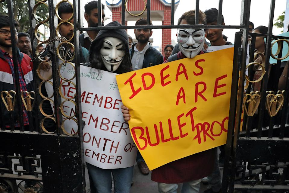 Demonstrators wearing Guy Fawkes masks arrive to attend a protest rally against a new citizenship law, in Kolkata, India, December 20, 2019. REUTERS/Rupak De Chowdhuri
