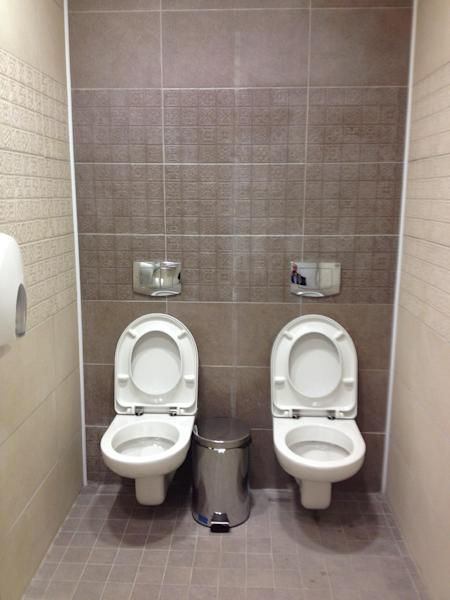 This photo taken on Friday Jan. 17, 2014, shows two toilets at the cross-country skiing and biathlon center for next month's Olympics in Sochi, Russia. Although two toilets and only one stall like this are not common in Russia, social media users have responded by posting other pictures of toilets standing side by side. One said this was standard at Russian soccer stadiums. (AP Photo/Steve Rosenberg, BBC)