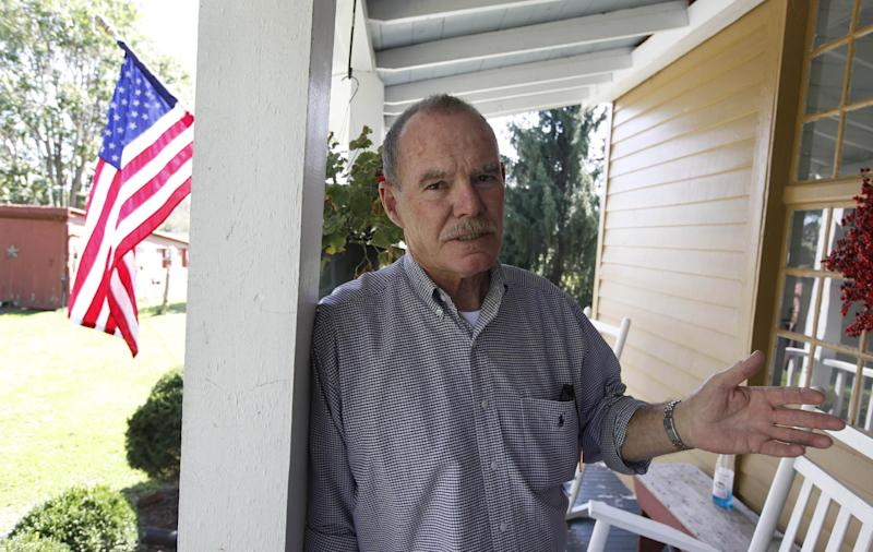 This photo taken Oct. 10, 2012 shows Virginia voter Harry Donahue on the front porch of his house, built in the 1700's, in Farmville, Va. Donahue, a 68-year-old retired chemical worker from Philadelphia's New Jersey suburbs, moved to Virginia in 2001 and brought with him an independent streak and a voting pattern that ranges from Ronald Reagan to Ross Perot. He plans to back Obama this year after supporting John McCain in 2008. (AP Photo/Steve Helber)