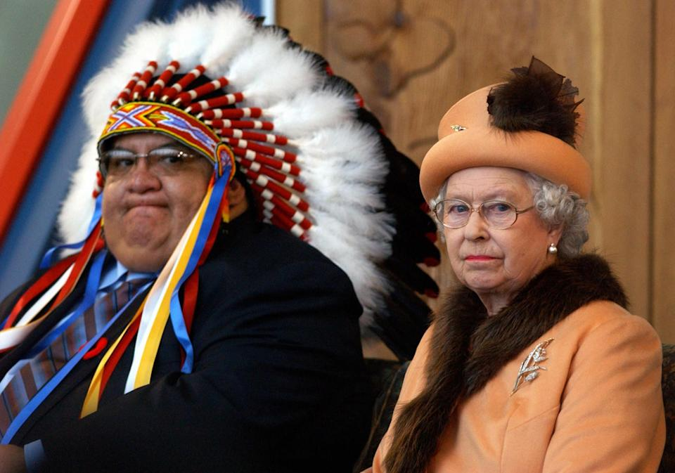<p>During a state visit to Canada, The Queen sits next to Chief Alphonse Bird of the Federation of Indian Nations, at the First Nations University. (PA Archive) </p>