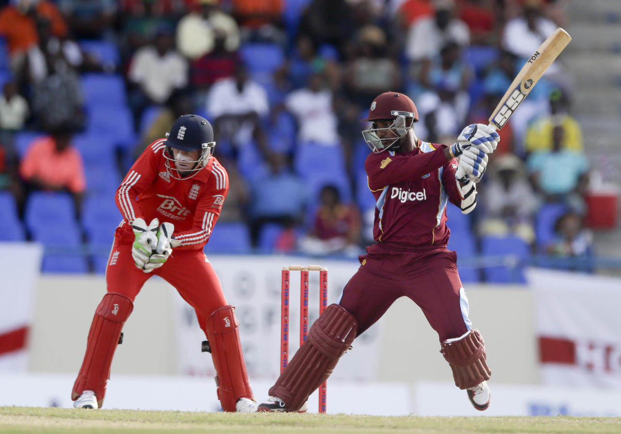 West Indies' Danesh Ramdin bats during the third one-day international cricket match against England at the Sir Vivian Richards Cricket Ground in St. John's, Antigua, Wednesday, March 5, 2014. (AP Photo/Ricardo Mazalan)