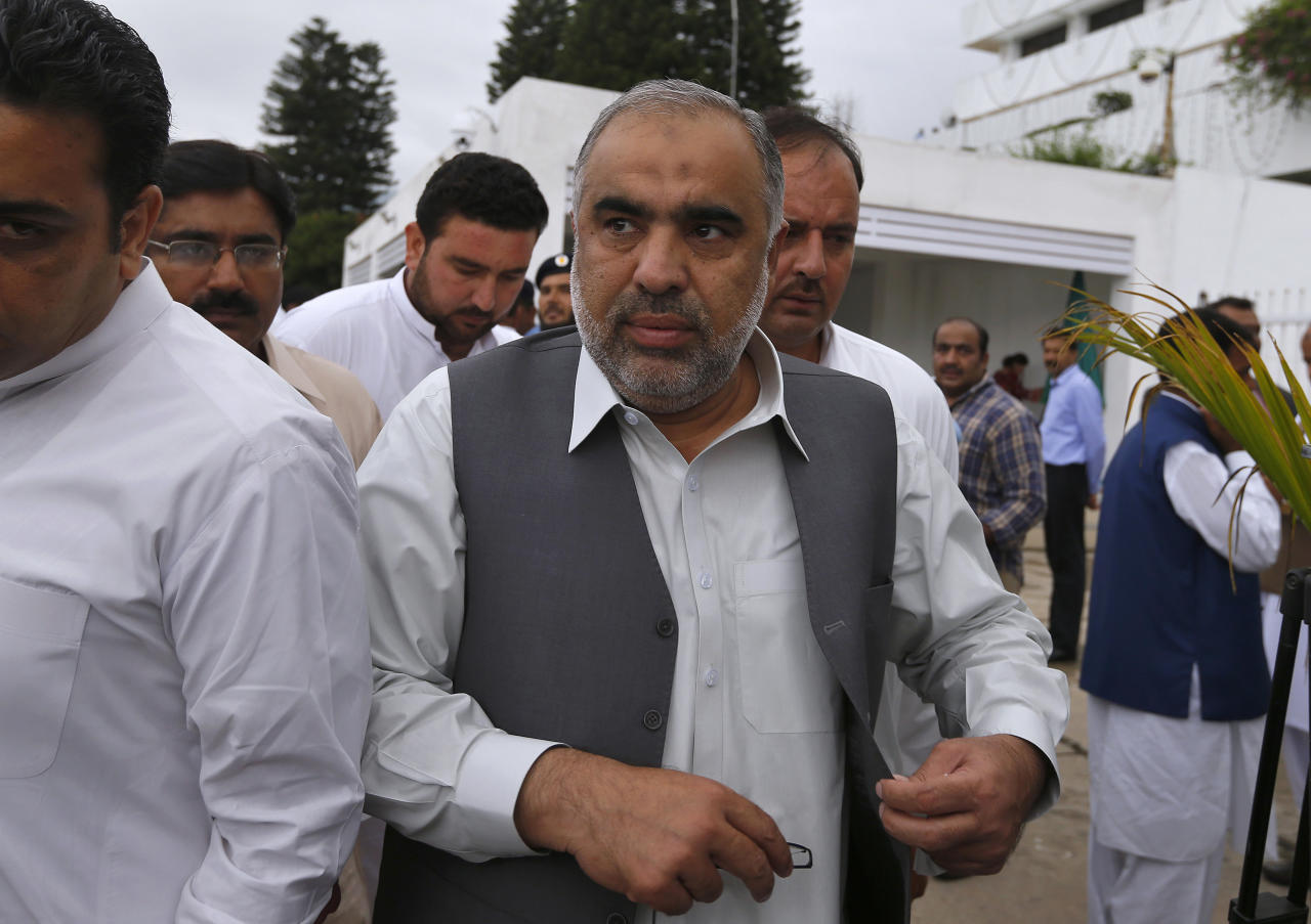 Newly elected lawmaker and candidate for speaker of the national assembly, Asad Qaiser, center, arrives to attend the first session of the lower house of parliament, in Islamabad, Pakistan, Monday, Aug. 13, 2018. Pakistan's newly elected parliament convened Monday for the first time since last month's general elections which saw former cricket star turned politician Imran Khan's party win most seats, propelling him toward the post of the country's next prime minister. (AP Photo/Anjum Naveed)