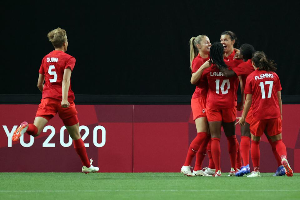 Canada's forward Christine Sinclair (3R) celebrates with teammates scoring the opening goal during the Tokyo 2020 Olympic Games women's group E first round football match between Japan and Canada at the Sapporo Dome in Sapporo on July 21, 2021. (Photo by ASANO IKKO / AFP) (Photo by ASANO IKKO/AFP via Getty Images)