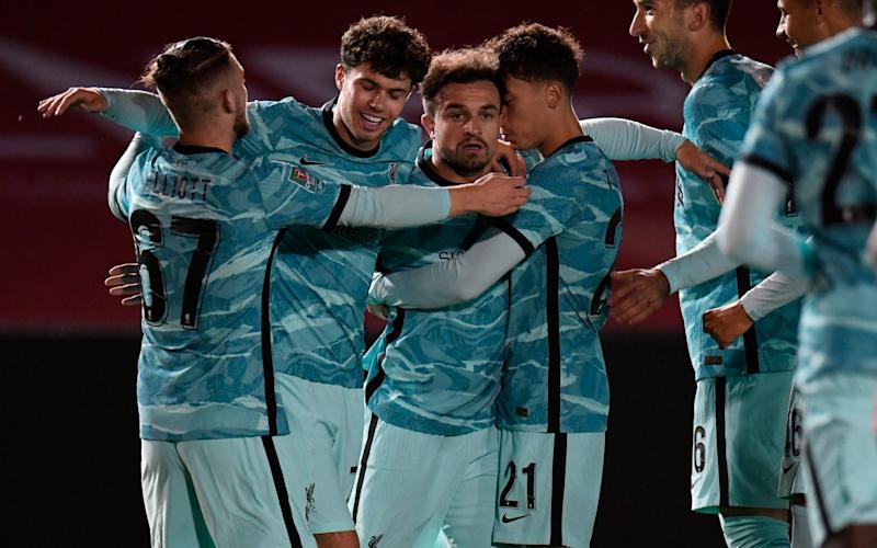 Xherdan Shaqiri of Liverpool celebrates with teammates after scoring his team's first goal during the Carabao Cup third round match between Lincoln City and Liverpool at Sincil Bank Stadium on September 24, 2020 in Lincoln, England.  - GETTY IMAGES