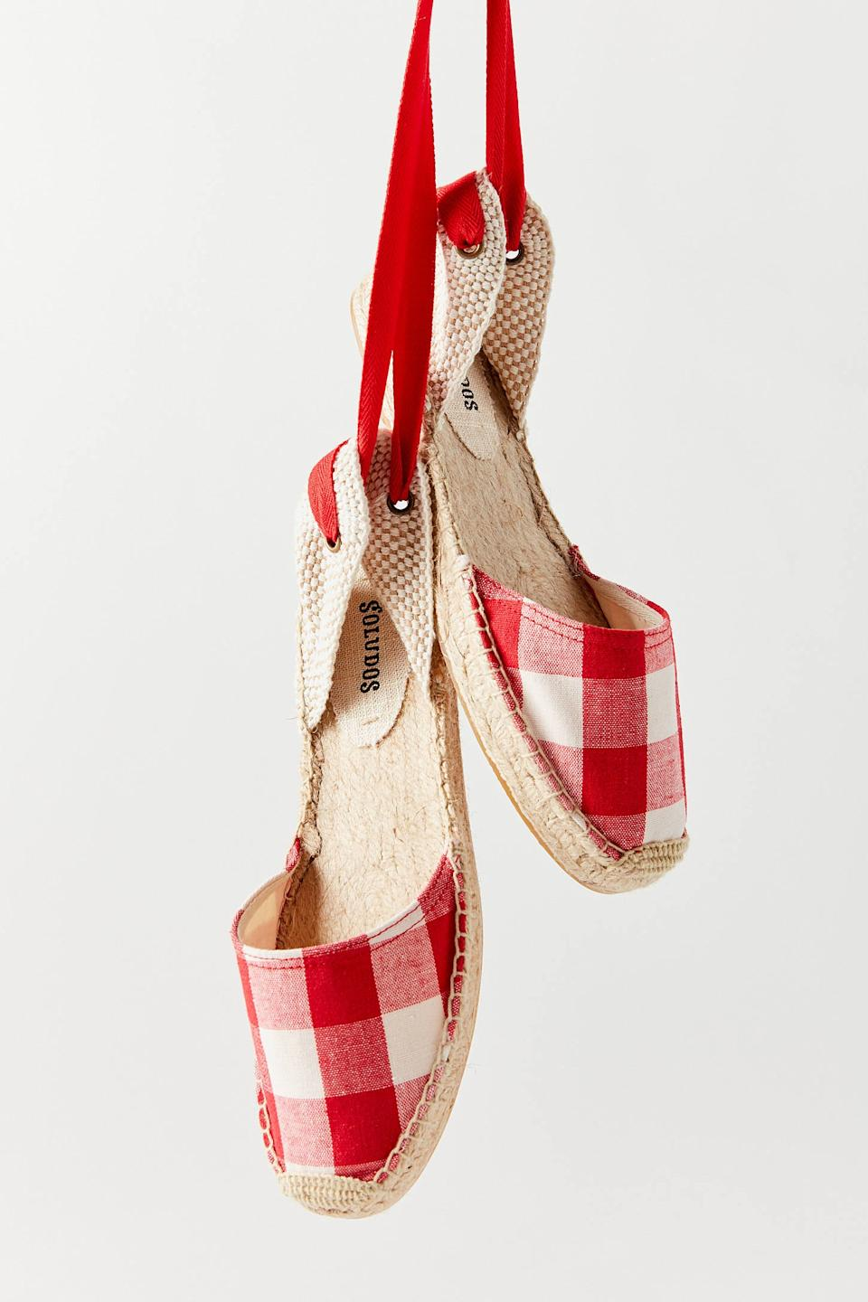 """<h2>Urban Outfitters</h2><br><strong>Deal: Up To 55% Off</strong><br>UO has its pulse on of-the-moment trends —and summer sandals are no exception. The retailer's virtual sale selection is rife with seasonal-footwear scores, including gems from <a href=""""https://www.urbanoutfitters.com/shop/soludos-linen-espadrille-tall-wedge-sandal"""" rel=""""nofollow noopener"""" target=""""_blank"""" data-ylk=""""slk:Soludos"""" class=""""link rapid-noclick-resp"""">Soludos</a> to <a href=""""https://www.urbanoutfitters.com/shop/camper-oruga-up-sandal"""" rel=""""nofollow noopener"""" target=""""_blank"""" data-ylk=""""slk:Camper"""" class=""""link rapid-noclick-resp"""">Camper</a> and <a href=""""https://www.urbanoutfitters.com/shop/rocket-dog-vega-webbing-sandal"""" rel=""""nofollow noopener"""" target=""""_blank"""" data-ylk=""""slk:Rocket Dog"""" class=""""link rapid-noclick-resp"""">Rocket Dog</a>.<br><br><em>Shop <strong><a href=""""https://www.urbanoutfitters.com/women-shoes-on-sale"""" rel=""""nofollow noopener"""" target=""""_blank"""" data-ylk=""""slk:Urban Outfitters"""" class=""""link rapid-noclick-resp"""">Urban Outfitters</a></strong></em><br><br><strong>Soludos</strong> Lauren Gingham Espadrille Sandal, $, available at <a href=""""https://go.skimresources.com/?id=30283X879131&url=https%3A%2F%2Fwww.urbanoutfitters.com%2Fshop%2Fsoludos-lauren-gingham-espadrille-sandal"""" rel=""""nofollow noopener"""" target=""""_blank"""" data-ylk=""""slk:Urban Outfitters"""" class=""""link rapid-noclick-resp"""">Urban Outfitters</a>"""