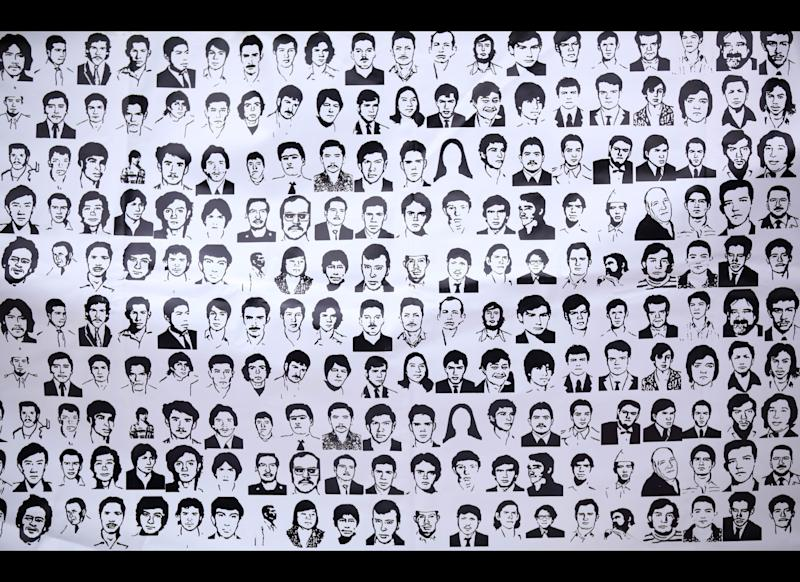 A banner shows ink drawings of missing people at the National March for Dignity on the day Mexicans celebrate el Dia de La Madre, or Mother's Day, in Mexico City, Thursday, May 10, 2012. Mothers and other relatives of persons gone missing in the fight against drug cartels and organized crime are demanding that authorities locate their loved ones. (AP Photo/Alexandre Meneghini)