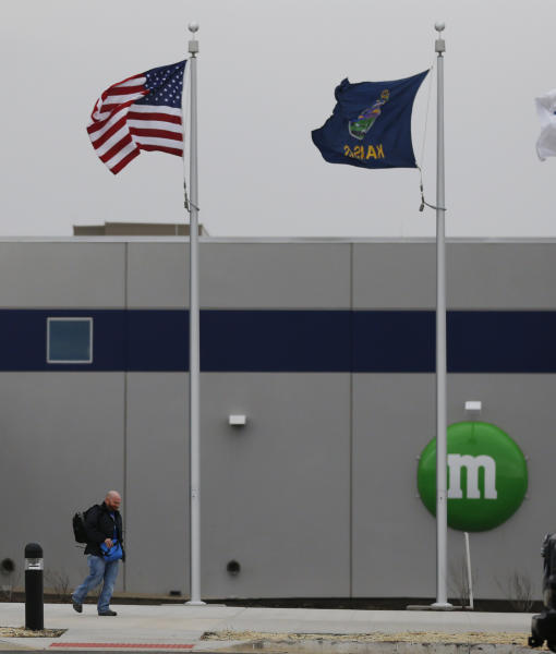 A man walks out the entrance of the new Mars Inc. production facility near Topeka, Kan., Wednesday, March 26, 2014. It's the company's first new North American production facility in 35 years. (AP Photo/Orlin Wagner)