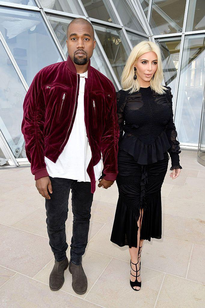 <p>The couple attend the Louis Vuitton show during Paris Fashion Week in March.</p>